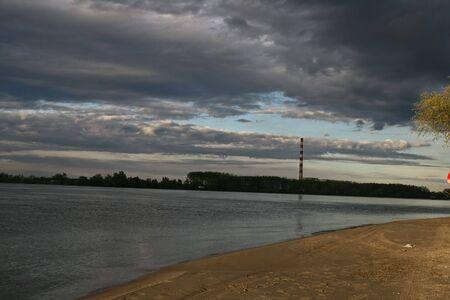 Nature on shore of river Danube in Petrovaradin, shore, sand, clouds, sky