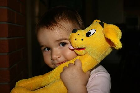 my daughter with a puppy toy