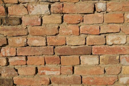 Closeup shot of old bricks wall on the old house Stock Photo