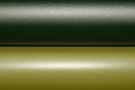 Closeup shot of rubber rollers with yellow color on offset print