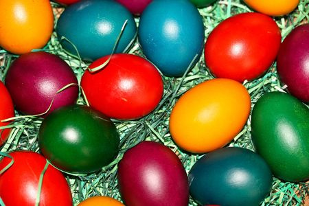 Eastern eggs in the different colour on the table in the prickle