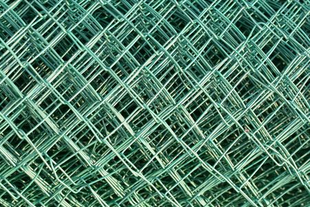 this is a shot of green plastic coated wire, like nice backgrounds