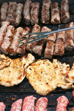 this is a close up shot of meat on the barbecue-grill
