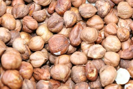this is a close up shot of bundle of hazelnuts, like nice food background