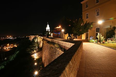 The walls of Petrovaradin fortress, promenade and old clock tower, by night, this is a place of Exit festival in Serbia Stock Photo - 5346774