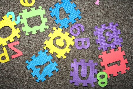 letters - puzzle,  scattered on the floor, as beautiful backgrounds photo