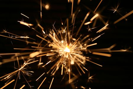 This is a closeup shot of sparkler in the dark, like nice background