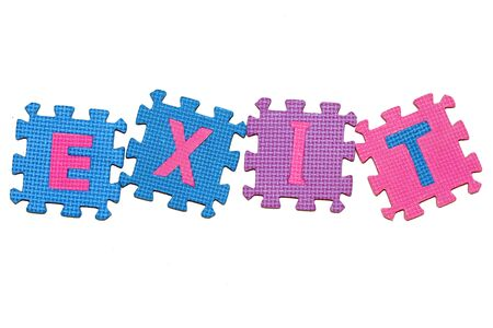 letters-puzzle, word EXIT, isolated on white background.  photo