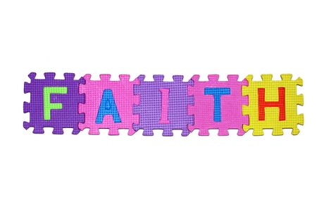 letters-puzzle, word FAITH, isolated on white background.  Stock Photo