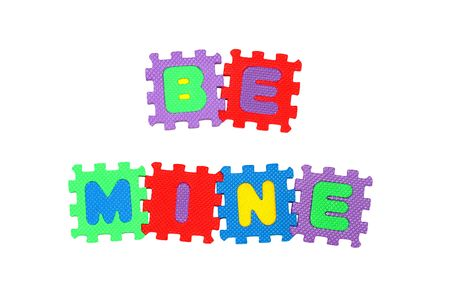 be mine: Message BE MINE from letter puzzle, isolated on white.