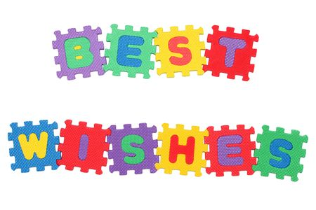 best wishes: Message BEST WISHES from letter puzzle, isolated on white. Stock Photo