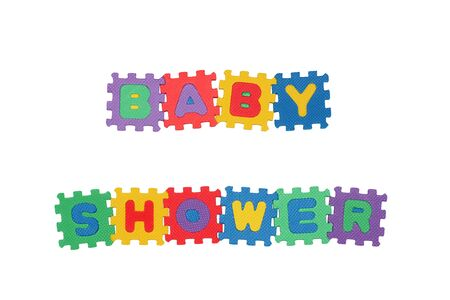Message BABY SHOWER from letter puzzle, isolated on white.