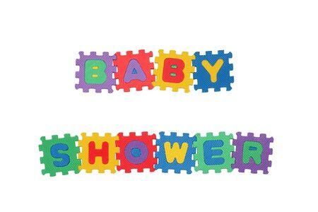Nachricht-BABY-Dusche aus Buchstaben Puzzle, isoliert auf weiss.