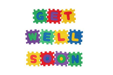 get in shape: Message GET WELL SOON from letter puzzle, isolated on white. Stock Photo