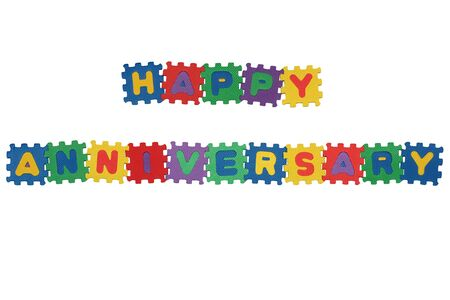 Message HAPPY ANNIVERSARY from letter puzzle, isolated on white. Stock Photo