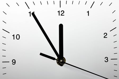 This is a closeup shot of clock, with 5 minutes to twelve.