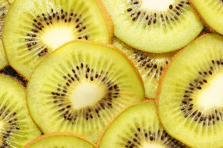 This is a closeup shot of kiwi slices, like nice background. Stock Photo