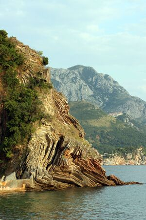 This is a closeup shot of some old cliff on the sea coast in Montenegro, like nice background. Stock Photo