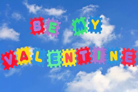 This is love note Be my Valentine, with sky and clouds in background. Stock Photo