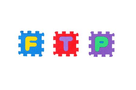 Word Ftp from letter puzzle, isolated on white. Stock Photo - 8761580