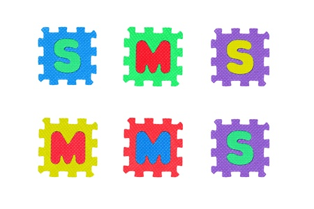 Abbreviations SMS and MMS, from letter puzzle, isolated on white. Stock Photo - 8761586
