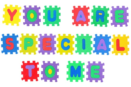 Romantic message, You are special to me, from letter puzzle, isolated on white. Stock Photo - 8761634
