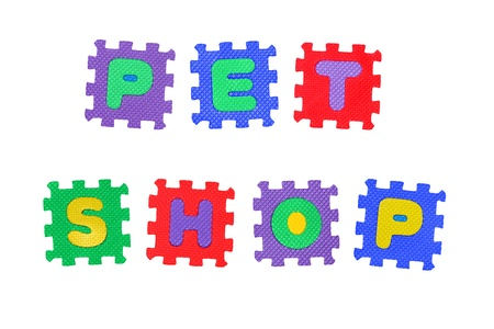Sign, Pet Shop, from letter puzzle, isolated on white background. Stock Photo - 8761636