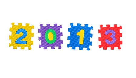 The year 2013 made of  number puzzle, isolated on white background. photo