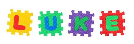 ルーク: 名前文字のパズル、白い背景で隔離のルークが作られました。