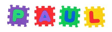 Der Name PAUL aus Buchstaben Puzzle, isoliert auf wei�em Hintergrund. Lizenzfreie Bilder