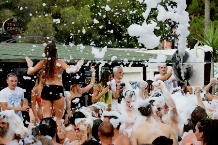 Foam Party on the beach in Igalo, Montenegro, 26 07 2014  Group of people enjoying in drinking, dancing and  music  Editorial