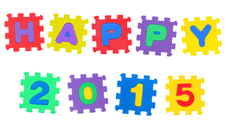 The Happy year 2015 made of  number puzzle, isolated on white background. Stock Photo