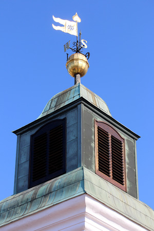 Old Fashioned Steel Weather Vane on the tower on Petrovaradin fortress. Stock Photo