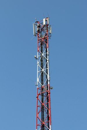 Mobile Phone Antenna with clear blue sky in the background.