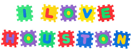 Message I Love Houston, from letters puzzle, isolated on white background.