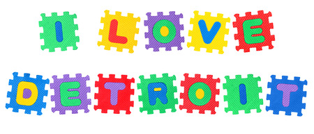 Message I Love Detroit, from letters puzzle, isolated on white background. Stock Photo