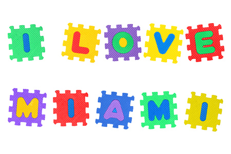 Message I Love Miami, from letters puzzle, isolated on white background. Stock Photo