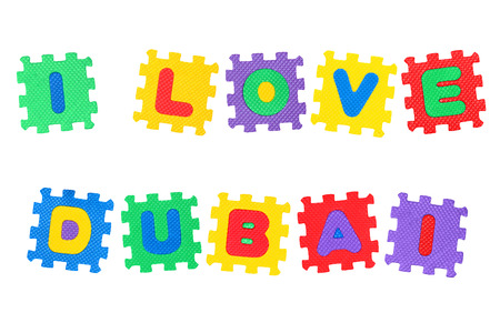 Message I Love Dubai, from letters puzzle, isolated on white background.