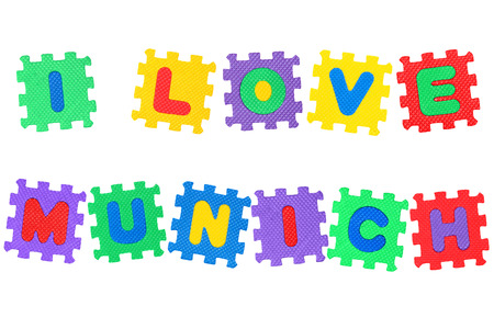 Message I Love Munichi, from letters puzzle, isolated on white background.