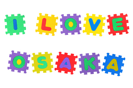 Message I Love Osaka, from letters puzzle, isolated on white background.