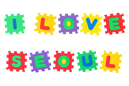 Message I Love Seoul, from letters puzzle, isolated on white background. Stock Photo