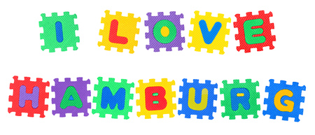Message I Love Hamburg, from letters puzzle, isolated on white background.