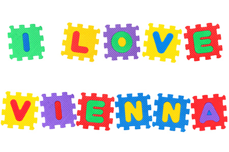 Message I Love Vienna, from letters puzzle, isolated on white background.