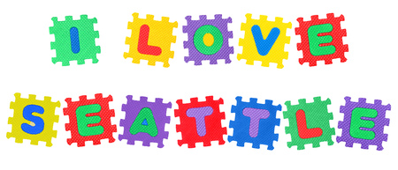 Message I Love Seattle, from letters puzzle, isolated on white background.