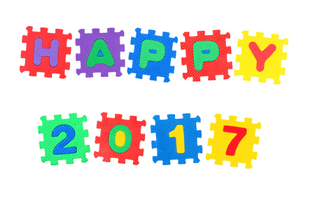 Message Happy 2017., from letters puzzle, isolated on white background. Stock Photo