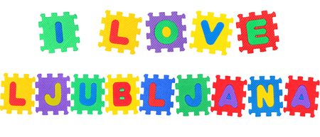 Message I Love Ljubljana, from letters puzzle, isolated on white background.
