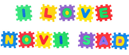 Message I Love Novi Sad, from letters puzzle, isolated on white background.