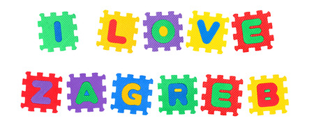 Message I Love Zagreb, from letters puzzle, isolated on white background.