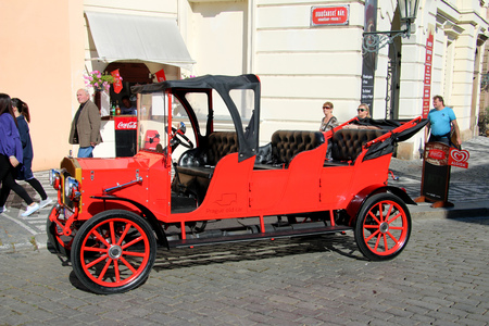 Beautiful old red car for sightseeing in Prague, Czech Republic. Editorial