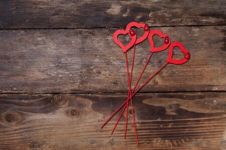 dearness: Red hearts on the wooden board